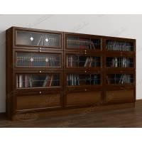 трехдверный шкаф для книг цвета яблоня